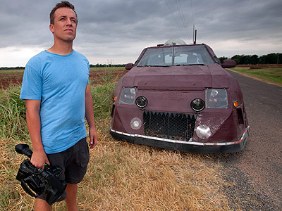 Storm Chaser Reed Timmer stands in front of the Dominator
