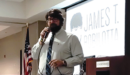 "Photo by Abigail Fallon Life coach James Robilotta speaks to lindenwood students about his motivational strategy ""PHEAM."""