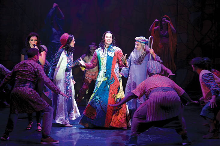 "Photo courtesy of josephthemusical.com JC McCann, center, performs as ""Joseph"" in his first major role in a touring Broadway production, coming to Lindenwood Thursday."