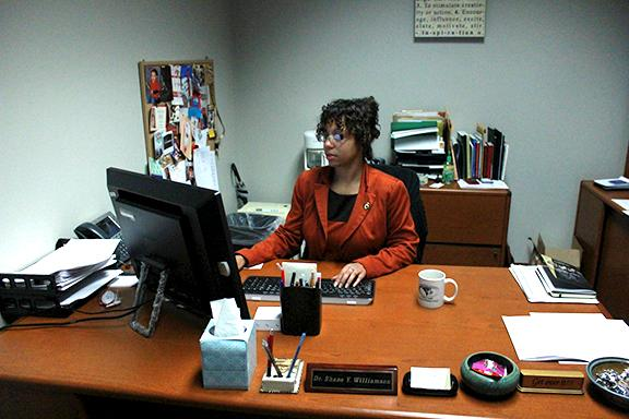Shane Williamson works at her desk in the Spellmann Center.  Photo by Lindsey Fiala