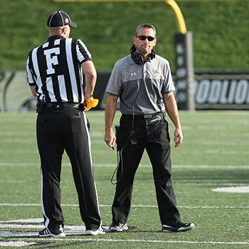 Photo by Carly Fristoe Former head football coach Patrick Ross looks away after discussing a call with an official during a 2016 home game.