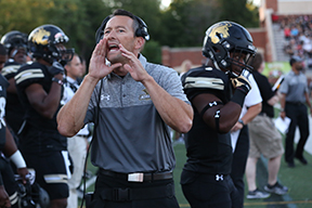 Photo by Carly Fristoe  Former Lindenwood football coach Patrick Ross yells to one of his players on the sidelines during the 2016 season.