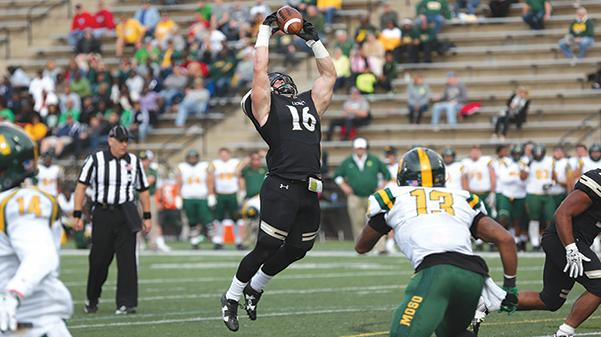Harris contributes to a 42-28 win over Missouri Southern State University in a November game.  Photo by Carly Fristoe