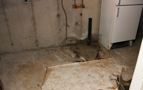 A basement from a house on Glenco street contains standing water and discoloration. Legacy photo by Christie Blecher.
