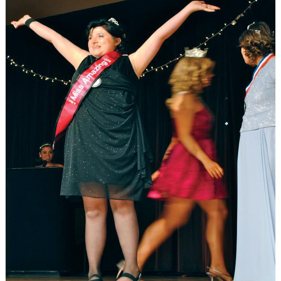 A young woman gets crowned as a Miss Amazing Pageant winner.