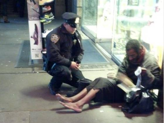 Jennifer Foster snapped this photo in Times Square showing NYPD officer Lawrence DePrimo giving a homeless man socks and boots. The image has swept through social media sites and made its way to the news networks.