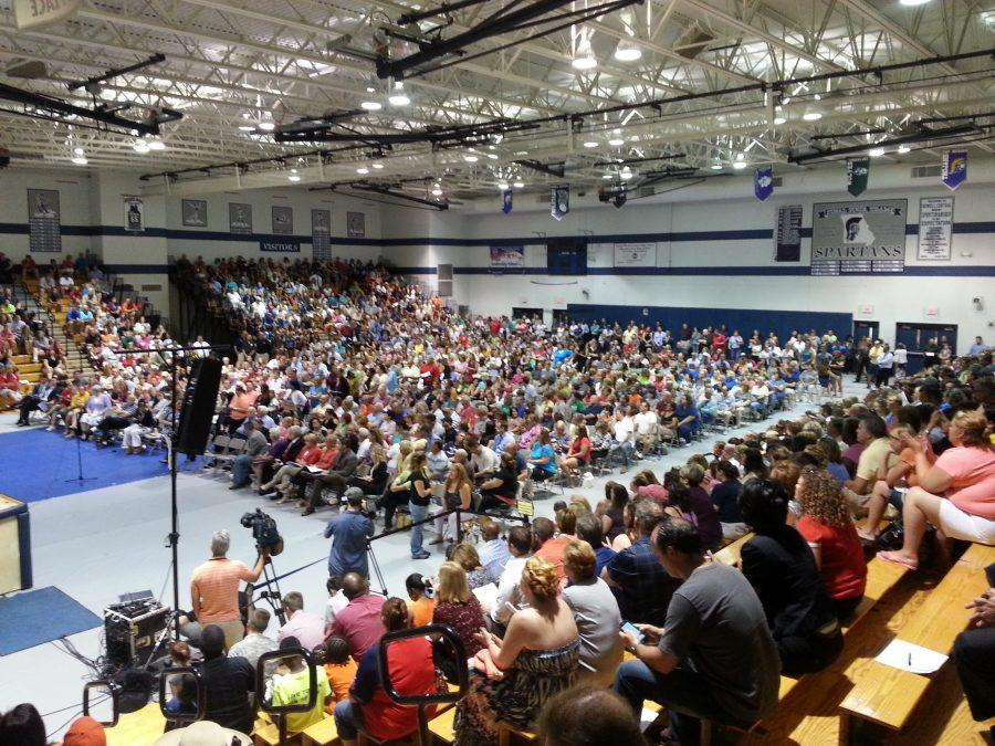 The+Francis+Howell+Central+gymnasium+was+packed+with+community+members+for+the+town+hall+meeting+on+July+11.+The+meeting+was+attended+by+an+estimated+3%2C000+people+