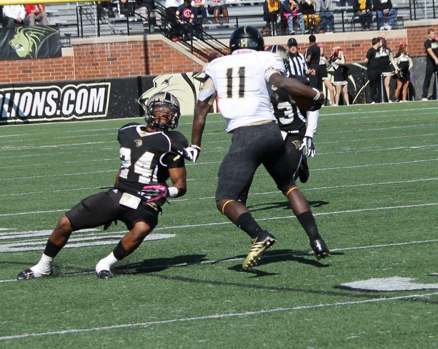 Lindenwood linebacker A.J. Chappelle (left) tries to regain his footing to tackle Hornets wide reciever Ray Ray Davis during the Lions' Homecoming game against Emporia State University in St. Charles Saturday.