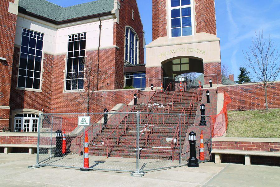 The fence was constructed Feb. 21 to prevent injury to students and faculty climbing the Spellmann Center brick staircase. Photo by Jennifer Bruhm
