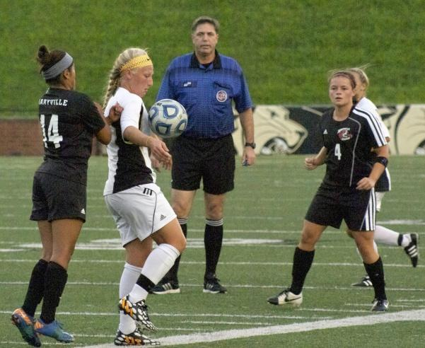 Kat Roe (7) controls the ball in a match against Maryville