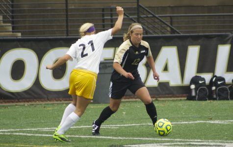 Kristin Brewer faces a MSSU defender in a game on Oct. 12.