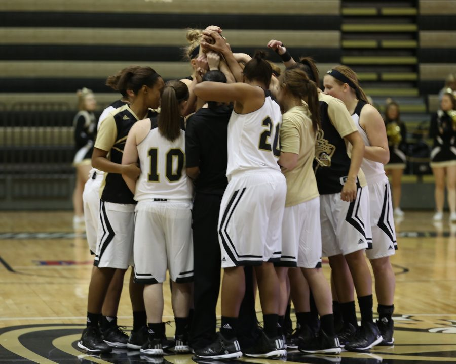 The+women%27s+basketball+team+huddles+at+center+court+during+a+game+earlier+this+season.