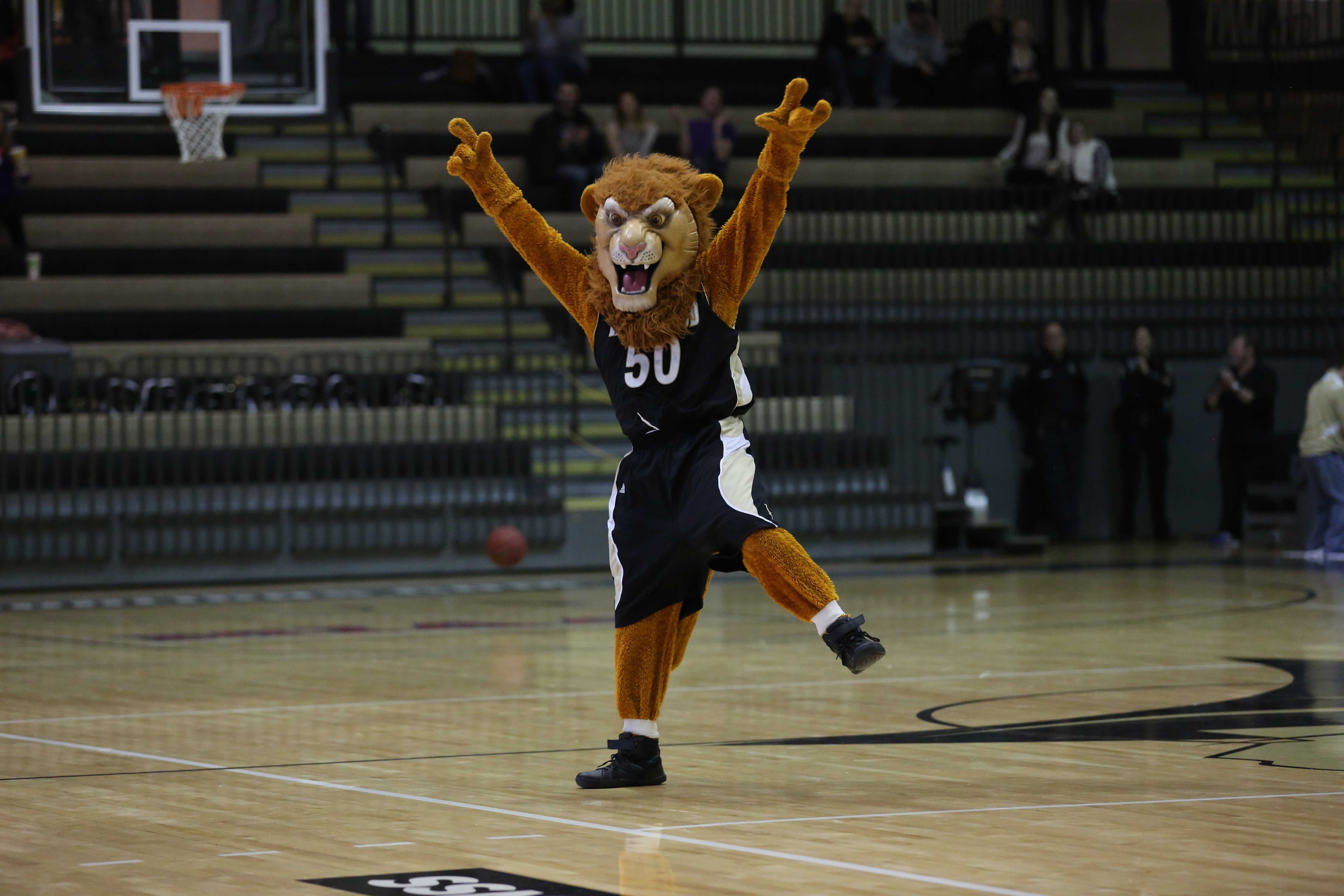 Lindenwood's mascot, Leo the lion celebrates after making a shot during halftime at the Jan. 15 game.