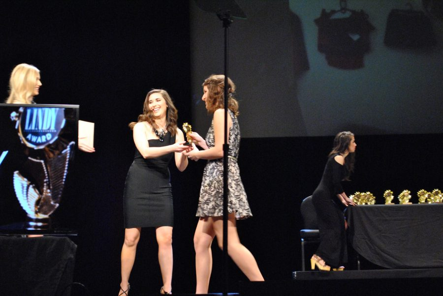 Audrey+Schroeder+accepts+a+Lindy+during+the+2014+awards+ceremony.+Schroeder+also+produced+the+2014+show.