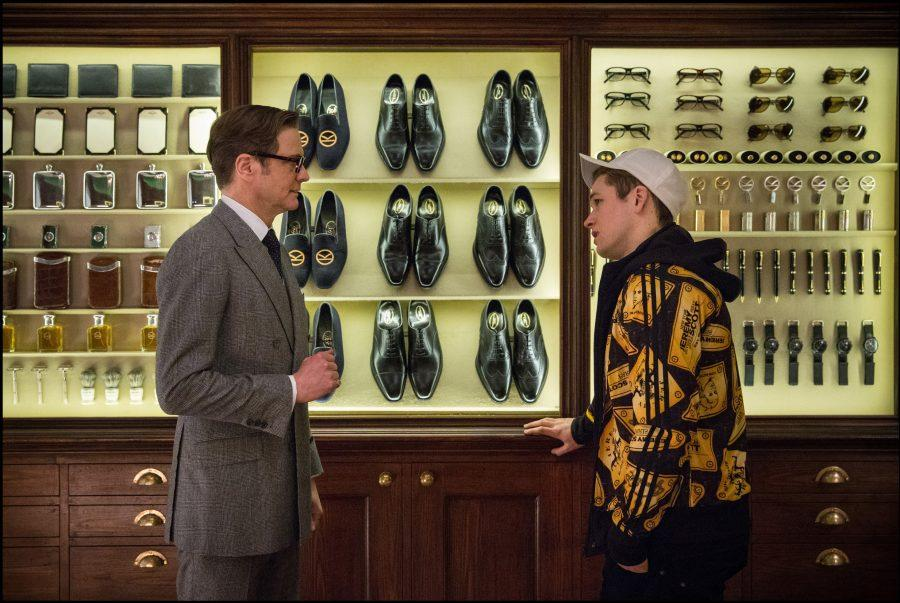 photo from epk.tv Harry (Firth) give young Eggsy (Egerton) a tour of Kingsman's stylish arsenal of covert weaponry
