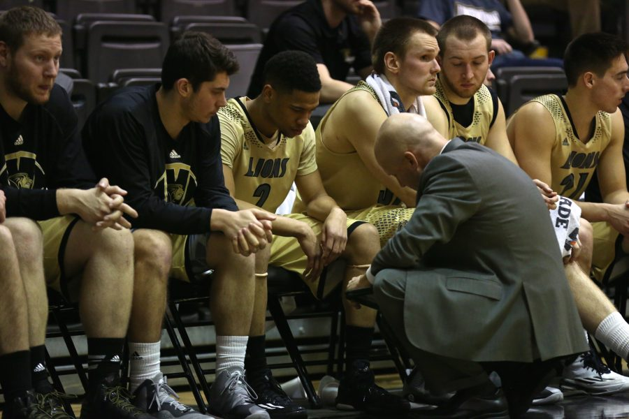 Head+coach+Brad+Soderberg+discusses+a+play+with+LJ+McIntosh+during+the+game+against+Lincoln.