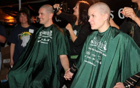 Photo by Amanda DeBerry Local volunteers shave their heads to raise awareness for childhood cancer.