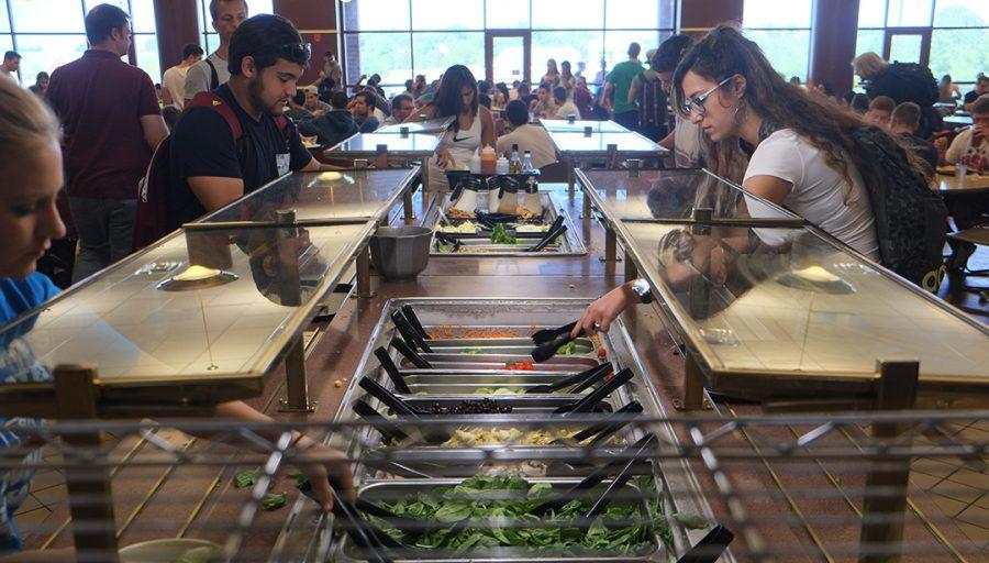 Photo by Nao Enomoto Students can now access the salad bar and condiment bar in the center of the Spellmann dining area. Previously, the salad bar was inside the food court, and the condiments were located on each side of the dining area.