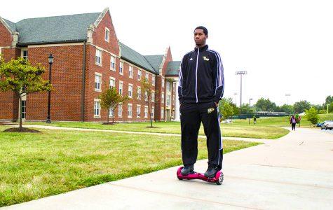 John Savvoy rides his hands-free Segway across campus. Photo by Sandro Perrino