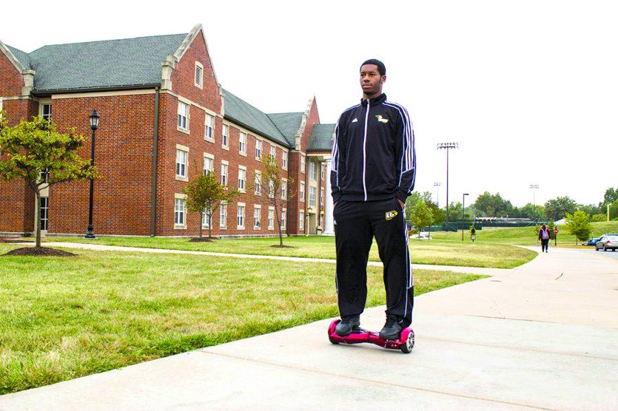 John Savvoy rides his hands-free Segway across campus. Photo by Sandro Perrino
