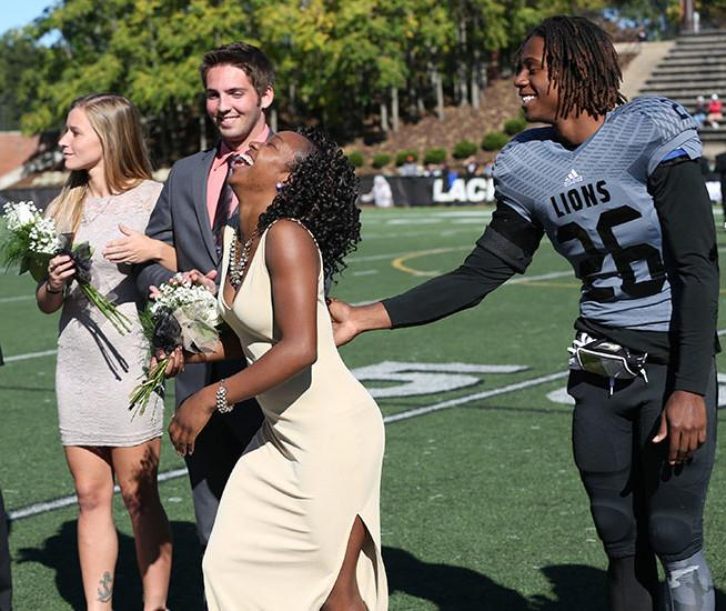 Photo by Carly Fristoe  |  Leviticus Knighten is overjoyed at winning the title of Homecoming queen.