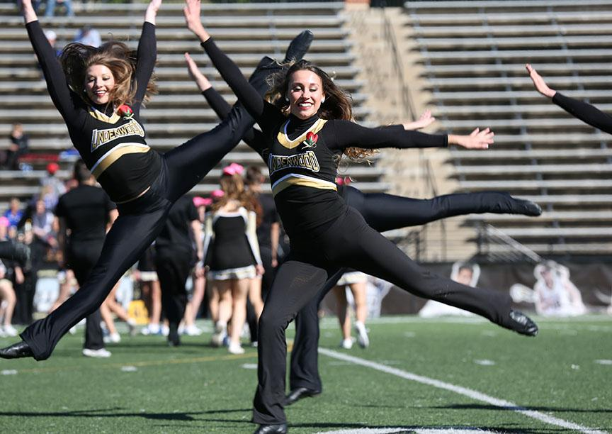 Photo by Carly Fristoe  |  Members of the Lion Line dance team maintain the high energy of the crowd during the halftime show.