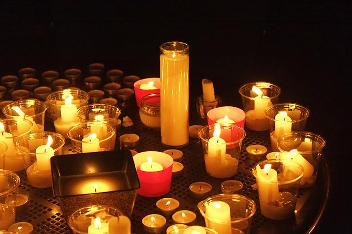 Students gathered and lit candles to remember the victims of the latest terror attacks.  Photo by Nao Enomoto