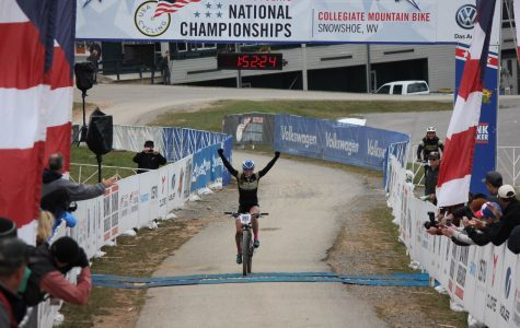 Finchamp crosses the finish line at the national championship, securing the 2015 Cross Country Mountain Bike title.<br> Photo courtesy of Hannah Finchamp