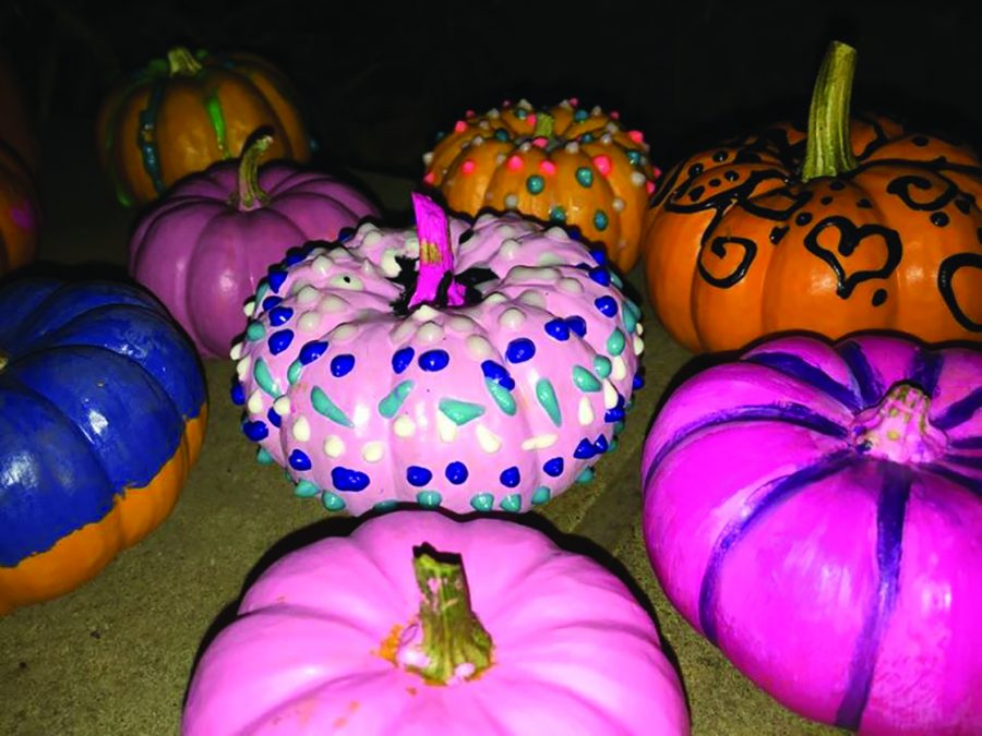 File photo by Viktoria Muench Painted pumpkins sit to dry at one of the Dark Carnival activity booths, which was hosted by Psi Chi.