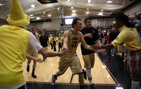 Second-half effort leads men's basketball to home opener win