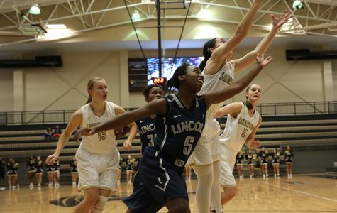 Rebounds lead women's basketball to home win