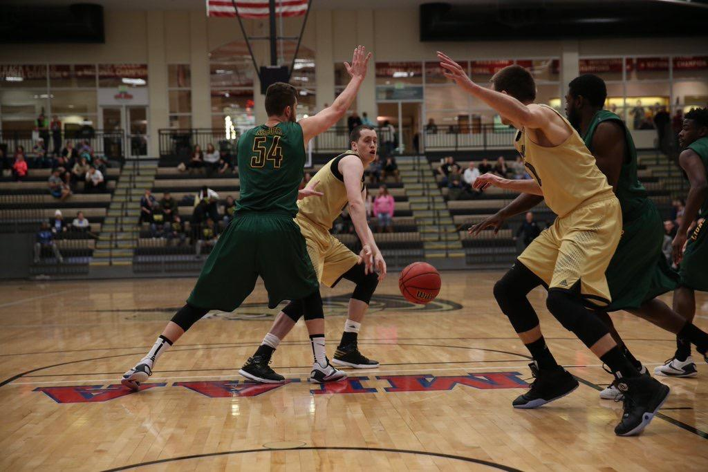 Lindenwood's Sam Mader attempts to guide a pass into Zach Biggs underneath the basket during the first half of the team's 69-68 win over Missouri Southern.   Photo by Carly Fristoe