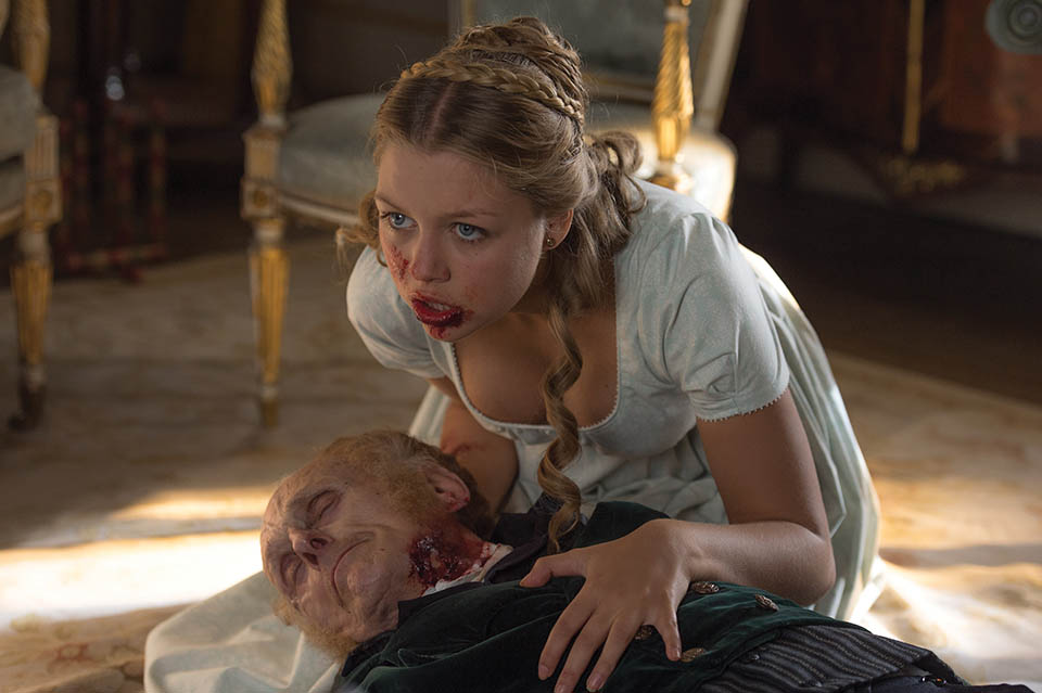 "Photo courtesy of Screen Gems A zombified Annabelle (Jess Radomska) feeds off her own grandfather in ""Pride and Prejudice and Zombies."""
