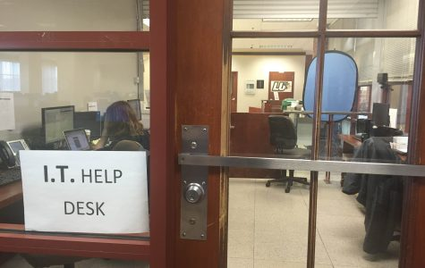 The I.T help desk is located on the third floor of the Spellmann Center.  <br> Photo by Devin King