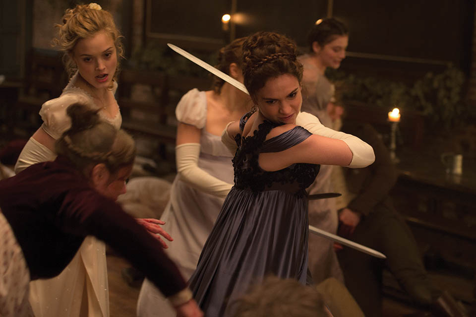 "Photo courtesy of Screen Gems Bella Heathcote and Lily James fight the undead in ""Pride and Prejudice and Zombies."""
