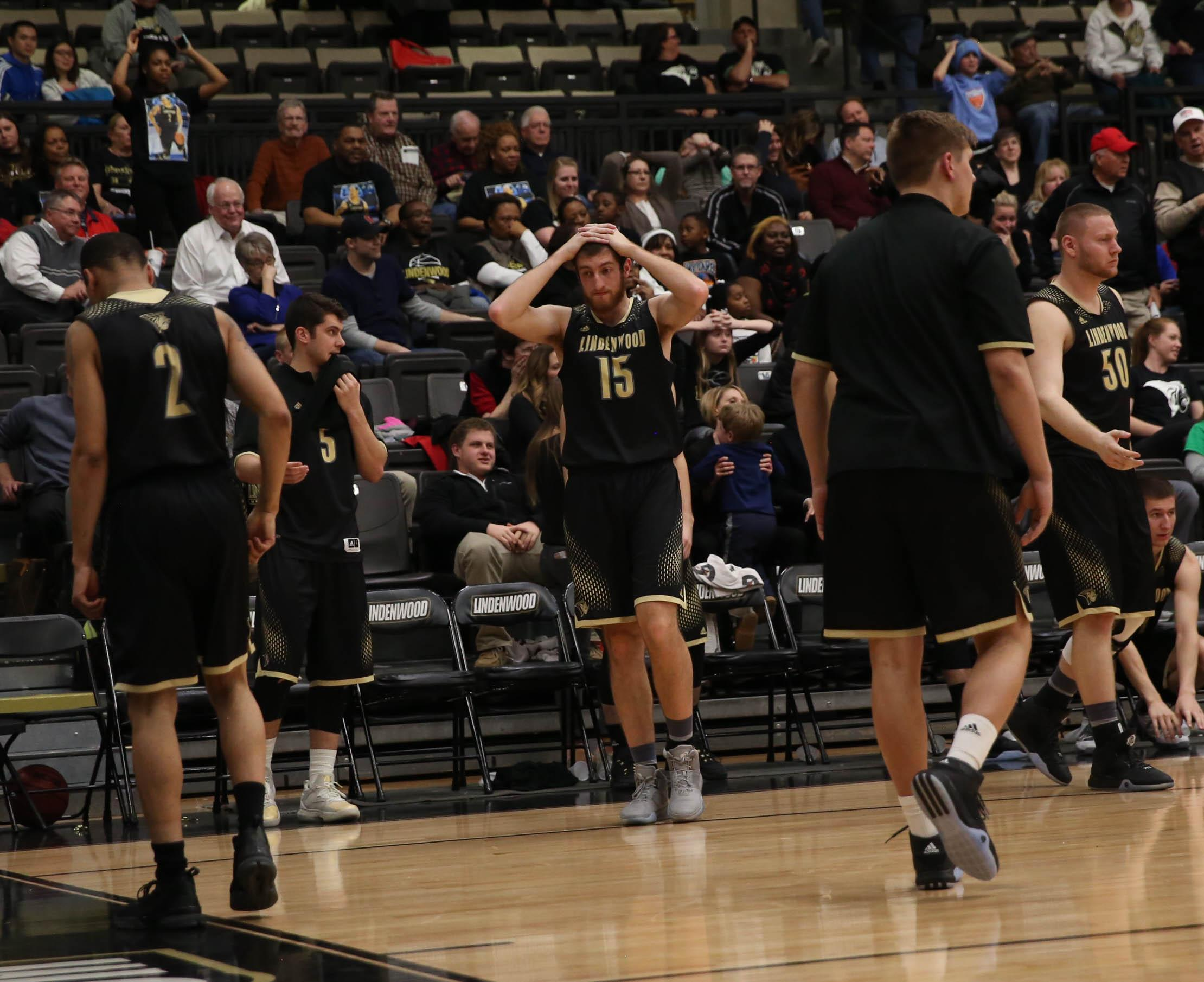 Rayko Dundalov holds his head in disbelief following the men's basketball team's 59-58 loss to UCM.   Photo by Carly Fristoe