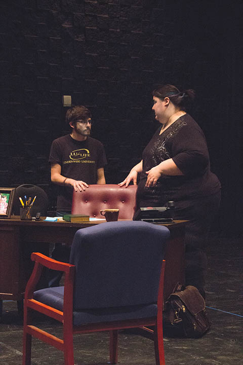 "Photo by Ana Castillo Rosie Portillo, right, directs Jake Blonstein in rehearsal of LU's production of ""Oleanna."""