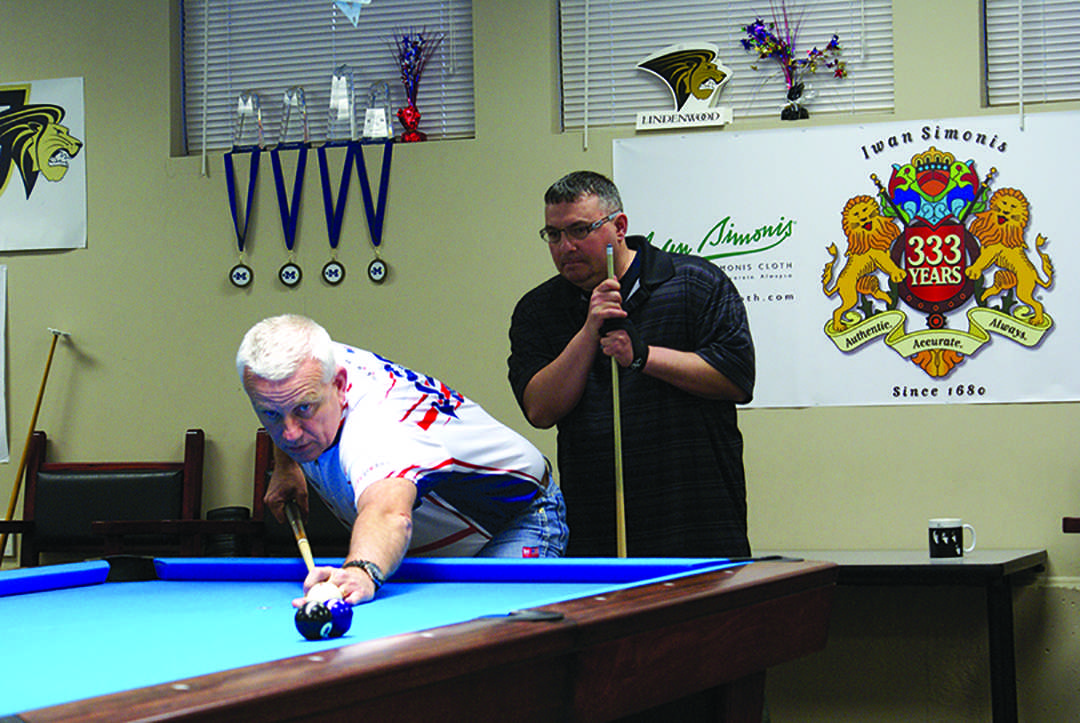 Photo by Phil Brahm Rob Geer looks on as billiards head coach Mark Wilson leads a lesson on technique at the Lindenwood Billiards Arena during Geer's visit to Lindenwood.