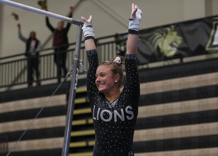 Valeri+Ingui+celebrates+after+tying+LU%E2%80%99s+top+mark+in+the+uneven+parallel+bars+with+a+score+of+9.825%2C+%3Cbr%3E+Photo+by+Carly+Fristoe