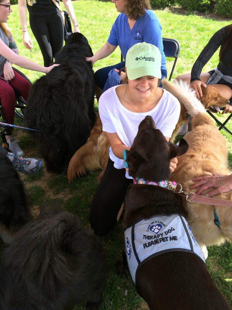 Photo by Jazmin del Angel Student Sarah Hall enjoys interacting with dogs brought to LU by Love on a Leash