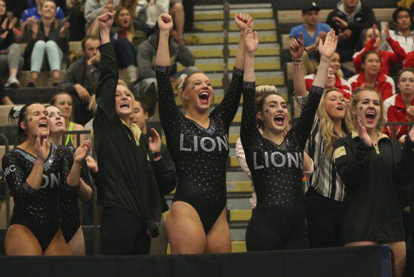 Members of the Lindenwood gymnastics team celebrate after their teammate completes a floor routine in the team finals. File Photo by Carly Fristoe