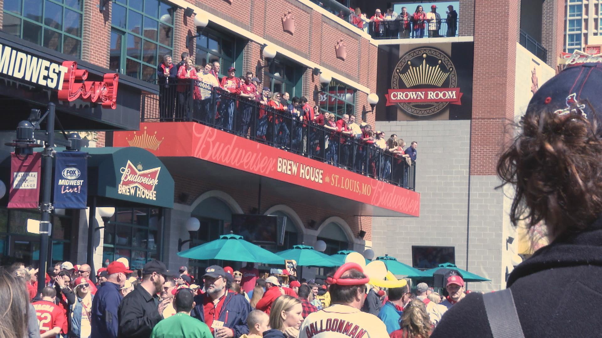 Fans gather outside Ballpark Village before the season home opener.