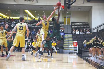 Photo by Carly Fristoe<br>Stanislas Heili attempts to block the shot of Missouri Aouthern's Charlie Brown last season.