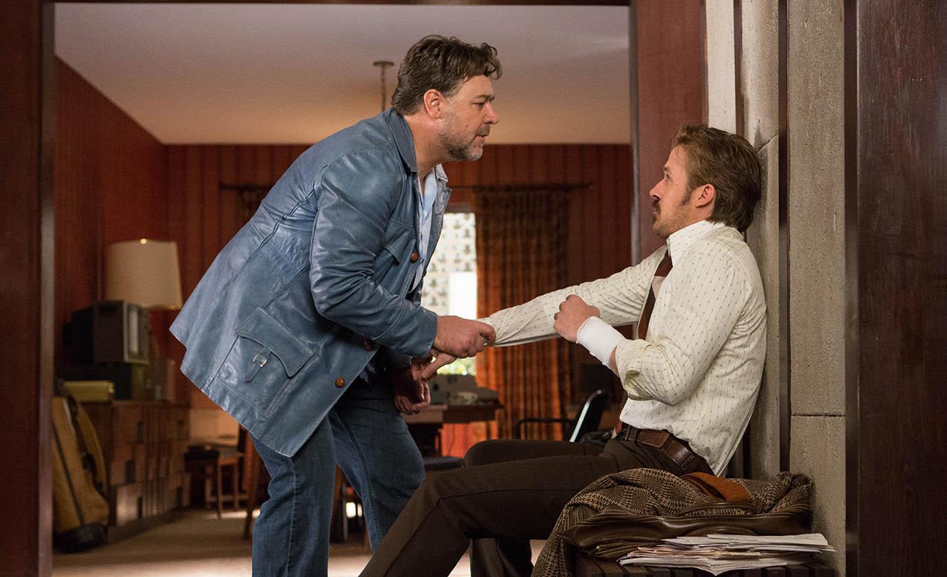 Photo courtesy of Warner Bros. Studios Hired arm Healy (Russell Crowe, left) and private eye March (Ryan Gosling) have an awkward initial meeting before later teaming up in