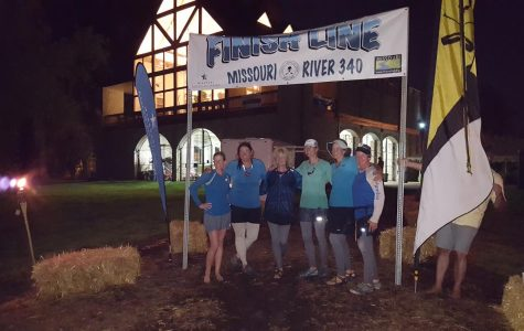 Team Boaty-licious stands at the finish line of the Missouri 340, said to be the longest non-stop river race.