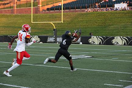 Lindenwood wide receiver Desean Warren catches a pass before running it into the endzone in the first half.