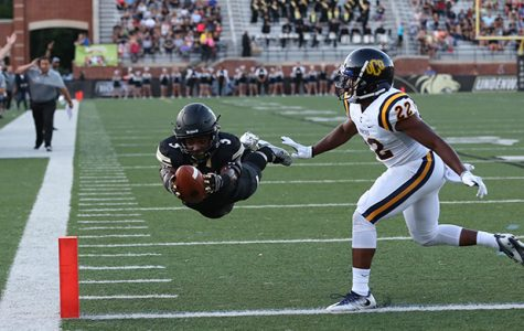 Lindenwood receiver Kendell Sparks dives horizontally into the endzone past Central Oklahoma defensive back Braden Calip for the team's first touchdown of the 2016 season. Sparks tallied 106 yards and two touchdowns in the home-opener on Sept. 1. <br />  Photo by Carly Fristoe