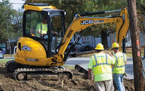 St. Charles City workers dig up the gas main by Droste Road. The main will be moved behind homes. <br />  Photo by Kelby Lorenz