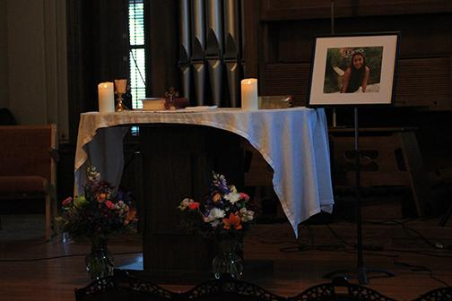 Photo by Lindsey Fiala Photo of Marianne Olyslager Maldonado is displayed at the altar during the service.
