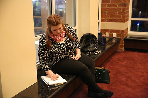 Photo by Carly Fristoe  Erin Olsen takes notes on  Laura Schulze's and Colby Danner's rehearsal of their One Act play.